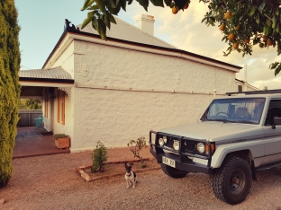 old cottage and car